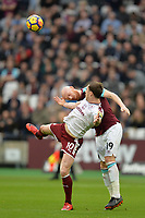 James Collins of West Ham clears from Ashley Barnes of Burnley  during West Ham United vs Burnley, Premier League Football at The London Stadium on 10th March 2018