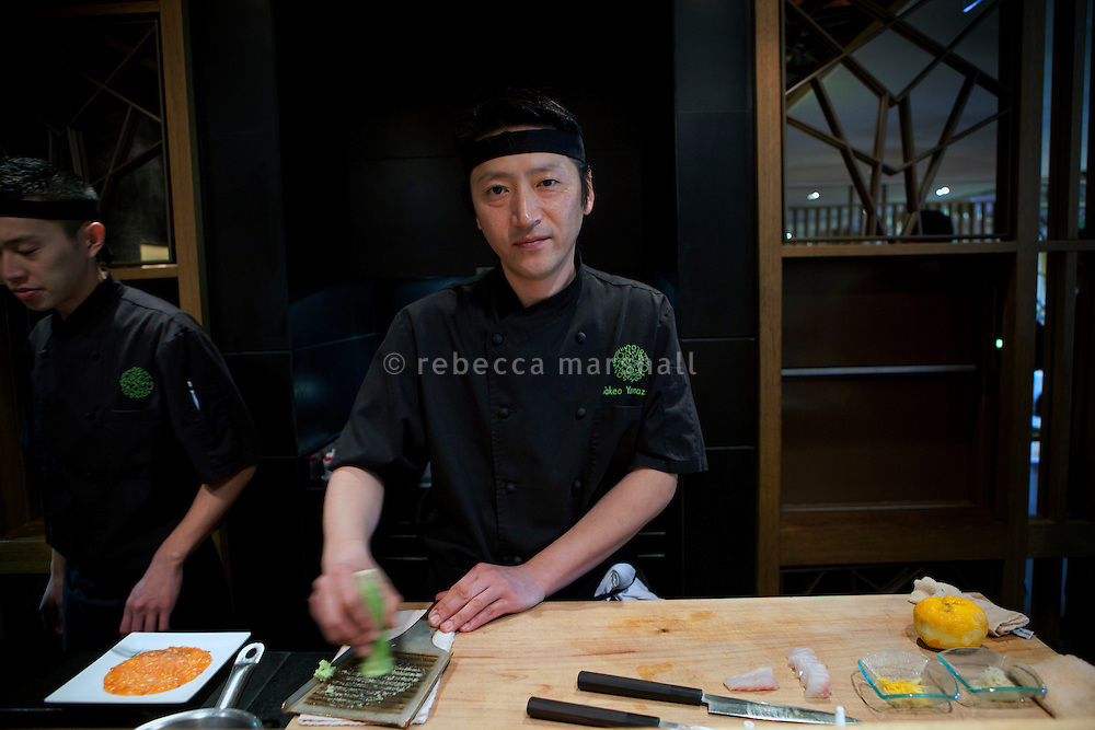 Head chef Takeo Yamazaki prepares wasabi at Yoshi restaurant at the Metropole Hotel, Monaco, 23 March 2012