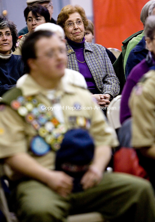 WATERBURY, CT - 10 FEBRUARY 2009 -021009JT07-<br /> Edith Wisausky attends a ceremony in which Michael LoVetro, foreground, was awarded the Medal of Merit Boy Scout badge for helping Wisausky as she was falling backwards on an escalator at Bradley Airport in July 2008. LoVetro, who is in Troop 302, was awarded the badge during a ceremony at the Waterbury ARC on Tuesday. Troop 302 is sponsored by the ARC of Waterbury, for boys with special needs. <br /> Josalee Thrift / Republican-American