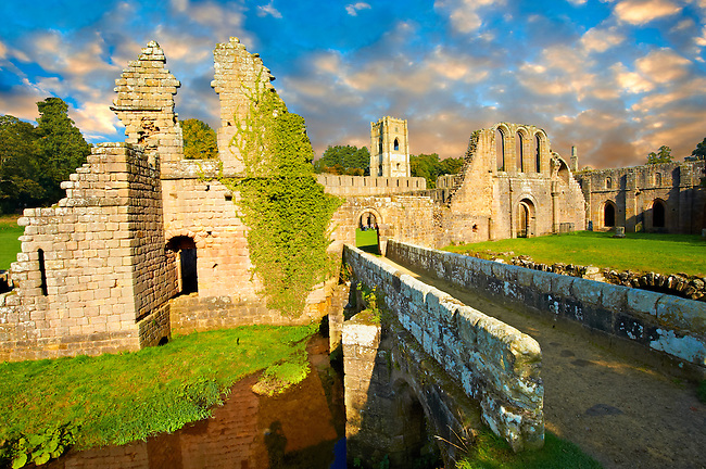 Entrance at sunrise  of the ruins of Fountains Abbey , founded in 1132, is one of the largest and best preserved ruined Cistercian monasteries in England. The ruined monastery is a focal point of England's most important 18th century Water, the Studley Royal Water Garden which is a UNESCO World Heritage Site. Near Ripon, North Yorkshire, England