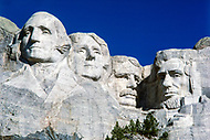 1927-1941, Mount Rushmore National Memorial, South Dakota, USA --- The heads of distinguished former US Presidents George Washington, Thomas Jefferson, Theodore Roosevelt and Abraham Lincoln (from L-R) dominate the valley at Mount Rushmore. | Located in: Mount Rushmore National Memorial. --- Image by © JP Laffont