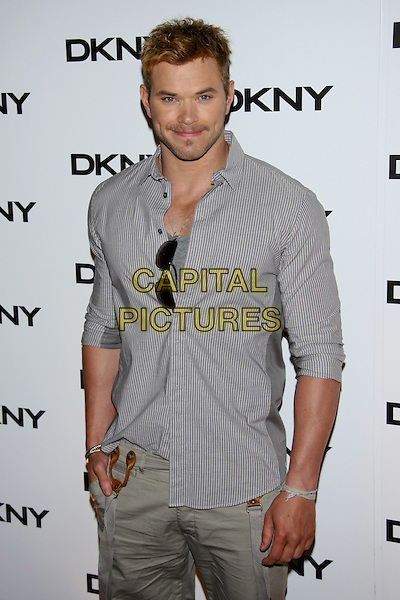 Kellan Lutz.The DKNY Sunglass Soiree at The Beach in the Dream Downtown Hotel, New York, NY, USA..July 26th, 2011.half length grey gray shirt stubble facial hair stripe.CAP/LNC/TOM.©TOM/LNC/Capital Pictures.