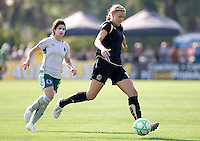 Sarah Walsh (left) pursues Carrie Dew (right). FC Gold Pride tied the St. Louis Athletica 1-1 at Buck Shaw Stadium in Santa Clara, California on August 9, 2009.