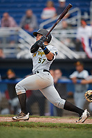 West Virginia Black Bears designated hitter Deon Stafford (57) hits a solo home run to left field in the top of the 8th inning during a game against the Batavia Muckdogs on June 25, 2017 at Dwyer Stadium in Batavia, New York.  West Virginia defeated Batavia 6-4 in the completion of the game started on June 24th.  (Mike Janes/Four Seam Images)