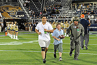 12 November 2011:  The game ball is delivered to the field prior to the game.  The FIU Golden Panthers defeated the Florida Atlantic University Owls, 41-7, to win the annual Shula Bowl game, at FIU Stadium in Miami, Florida.