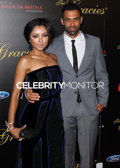 BEVERLY HILLS, CA, USA - MAY 20: Kat Graham, Cottrell Guidry at the 39th Annual Gracie Awards held at The Beverly Hilton Hotel on May 20, 2014 in Beverly Hills, California. (Photo by Xavier Collin/Celebrity Monitor)