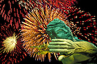"annual Independence Day celebration fireworks display behind """"Spirit of Detroit"""" statue by local sculptor Marshall Fredericks at City-County Building. Detroit Michigan USA downtown."