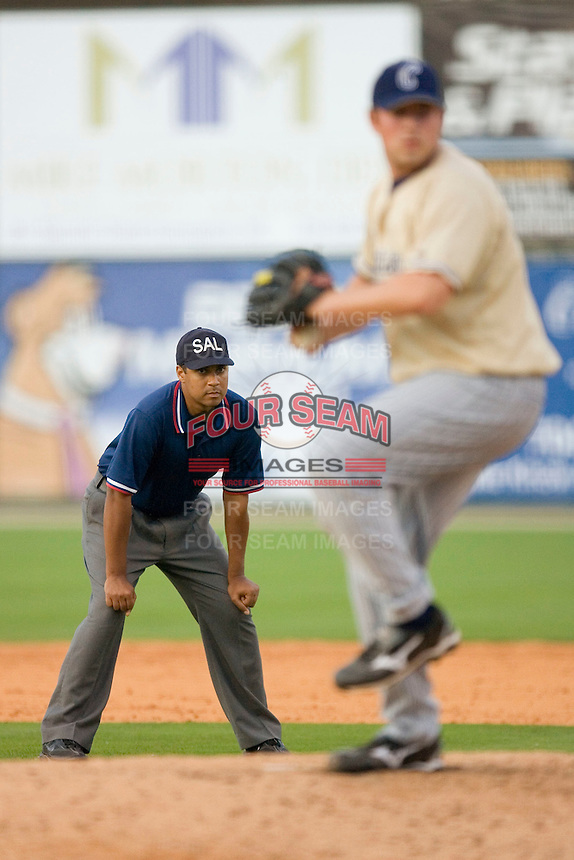 Umpire Eric Hill watches the action from n=behind the pitchers mound at Fieldcrest Cannon Stadium May 3, 2009 in Kannapolis, North Carolina. (Photo by Brian Westerholt / Four Seam Images)