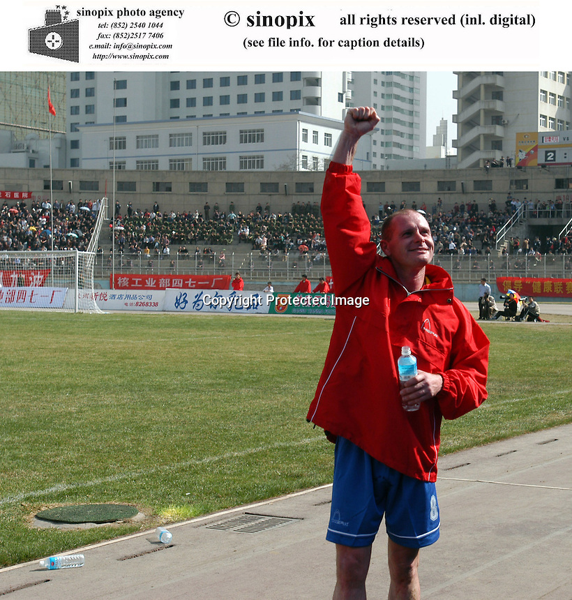 Football fans cheer for Paul Gascoigne during the game between Gansu Tianma and celebrates teammate Hao Long after the game bwtween Qingdao Hailifeng  in  Lanzhou, the capital of China's north-west Gansu province. Tianma won 2-0 at the match.<br />29-MAR-03