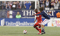 Foxborough, Massachusetts - October 25, 2014: First half action. In a Major League Soccer (MLS) match, the New England Revolution (blue/white) vs Toronto FC (red), 1-0 (halftime), at Gillette Stadium.