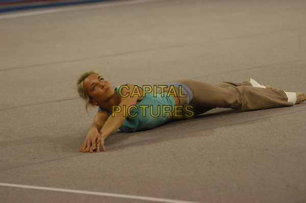 LADY ISABELLA HERVEY.The Games - Channel 4.April 12th, 2004.full length gymnastic routine funny lying down.www.capitalpictures.com.sales@capitalpictures.com.©Capital Pictures