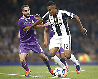 Calcio, Champions League: finale Juventus vs Real Madrid. Cardiff, Millennium Stadium, 3 giugno 2017.<br /> Juventus Alex Sandro (r) in action with Real Madrid's Dani Carvajal (l) during the Champions League final match between Juventus and Real Madrid at Cardiff's Millennium Stadium, Wales, June 3, 2017. Real Madrid won 4-1.<br /> UPDATE IMAGES PRESS/Isabella Bonotto