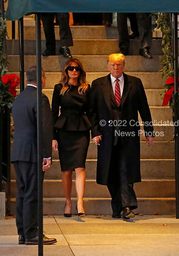 United States President Donald J. Trump and First lady Melania Trump depart Blair House following a brief visit with former US President George W. Bush and wife, former first lady Laura Bush, where the two are staying prior to the State Funeral tomorrow for former US President George H.W. Bush, in Washington, D.C., December 4, 2018.<br /> Credit: Martin H. Simon / CNP