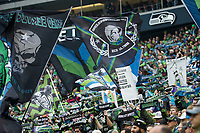 SEATTLE, WA - NOVEMBER 10: Seattle Sounders fans wave flags during a game between Toronto FC and Seattle Sounders FC at CenturyLink Field on November 10, 2019 in Seattle, Washington.