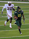 10/02/10-- Oregon's LaMichael James sprints past Stanford's Austin Yancy enroute to a 76- yard touchdown as the Ducks defeated Stanford 52-31at Autzen Stadium in Eugene, Or..Photo by Jaime Valdez......