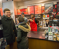 Starbucks workers during the first day of the Starbucks Cheer promotional event in New York on Friday, December 23, 2016. For the next 10 days, excluding Christmas, Starbucks is giving away a tall espresso drink of your choice between the hours 1 and 2PM at a rotating choice of 100 stores around the country. (© Richard B. Levine)