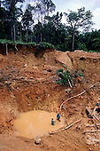 Maria Bonita, Xingu, Brazil. Garimpo illegal gold mine with garimpeiros waist deep in muddy water. Para State.