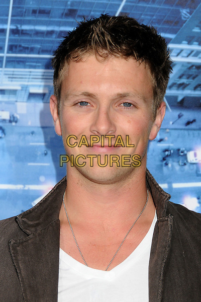Charlie Bewley.L.A. Premiere of  'Man on a Ledge' held at The Grauman's Chinese Theatre in Hollywood, California, USA..January 23rd, 2012 .headshot portrait brown white.CAP/ADM/BP.©Byron Purvis/AdMedia/Capital Pictures.