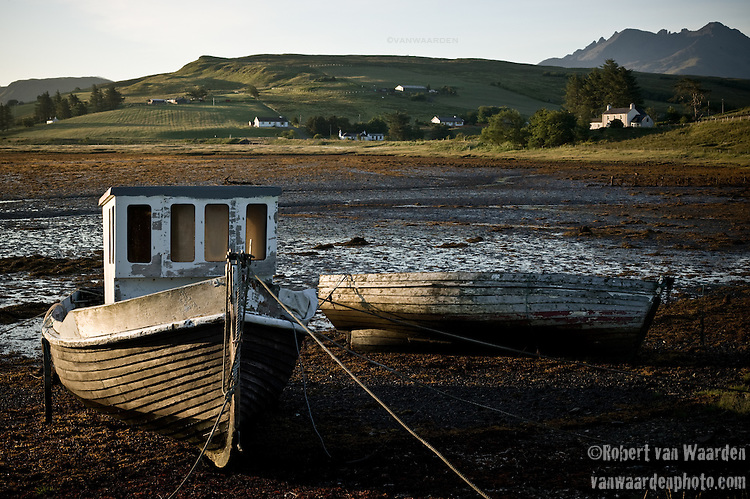 Two fishing boats rest on the ground during low tide, Isle of Skye, Scotland.
