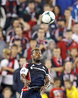 New England Revolution defender Jose Goncalves (23) heads the ball.  In a Major League Soccer (MLS) match, the New England Revolution (blue) defeated D.C. United (white), 2-1, at Gillette Stadium on September 21, 2013.