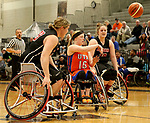 MARSHALL, MN - MARCH 17:  Morgan Wood #10 from University of Texas Arlington passes the ball out of a double team against Alabama during their championship game at the 2018 National Intercollegiate Wheelchair Basketball Tournament at Southwest Minnesota State University in Marshall, MN. (Photo by Dave Eggen/Inertia)