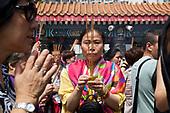 Worshippers pray at the Wong Tai Sin temple in Hong Kong.