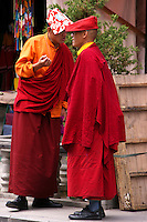 Tibetan Monks having a chat on the streets of Lhasa at Barkhor Square