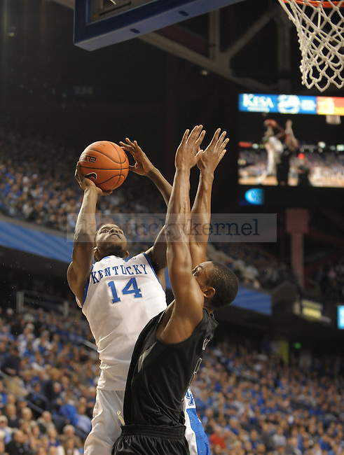 Michael Kidd-Gilchrist (14) takes a contested shot during the first half of the University of Kentucky Basketball game against Loyola at Rupp Arena in Lexington, Ky., on 12/22/11. UK led at half 45-39. Photo by Mike Weaver | Staff
