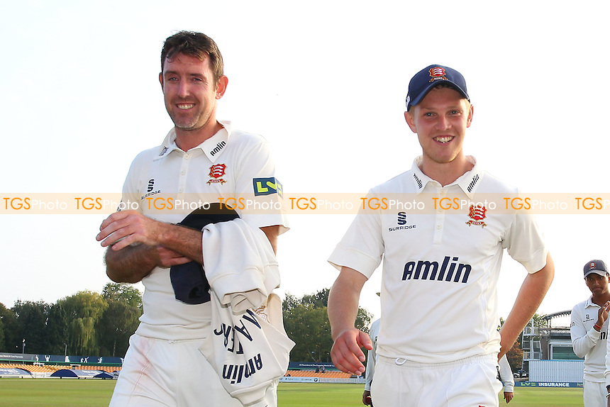 Essex players David Masters (L) and Jamie Porter leave the field after clinching victory - Leicestershire CCC vs Essex CCC - LV County Championship Division Two Cricket at Grace Road, Leicester - 16/09/14 - MANDATORY CREDIT: Gavin Ellis/TGSPHOTO - Self billing applies where appropriate - contact@tgsphoto.co.uk - NO UNPAID USE