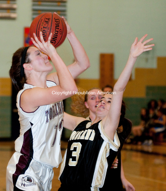 WATERBURY, CT, 21 FEBRUARY 2011-022111JS11--Torrington's Taylor Christiano (12) puts up a shot in front of Woodland's Ashely Breive (3) during their semi-final game of the NVL girls basketball tournament Monday at Kennedy High School in Waterbury. <br /> Jim Shannon/Republican-American