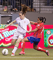 Heather O'Reilly, left, of the United States passes the ball while Daniela Cruz of Costa Rica holds on during play in the CONCACAF Olympic Qualifying semifinal match at BC Place in Vancouver, B.C., Canada Friday Jan. 27, 2012. The United States won the match 3-0 to earn a berth in 2012 London Olympics.