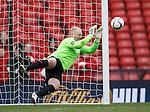 Hibs keeper Conrad Logan saves the second penalty kick