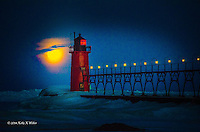 Moon setting on Lake Michigan spring with catwalk lights glowing along with the moon. Heavily edited image to lighten.