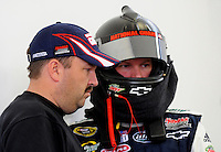 Feb. 28, 2009; Las Vegas, NV, USA; NASCAR Sprint Cup Series driver Dale Earnhardt Jr (right) with crew chief Tony Eury Jr during practice for the Shelby 427 at Las Vegas Motor Speedway. Mandatory Credit: Mark J. Rebilas-
