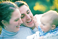 Family with Mother, father and son laughing outdoors