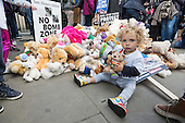 London, UK. 22 October 2016. Coby Atterton, 2 years, playing with teddy bears and other cuddly toys outside Downing Street. Several hundred campaigners staged a 'Save the Children of Aleppo' outside Downing Street calling on PM Theresa May to step up the UK Government efforts to help end the suffering of civilians in the beleaguered Syrian city of Aleppo. In total, 200 bears were piled up outside Downing Street, marking the number of children killed in Aleppo since a ceasefire broke down in mid-September. There are thought to be approximately 100,000 children still currently trapped in eastern Aleppo.