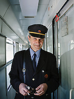 Portrait of a conductor on-board the train from Mostar to Sarajevo. The route is said to be one of the most beautiful train ride in the world.