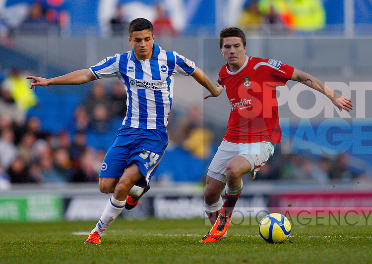 Adrian Cieslewicz of Wrexham holds off Ben Sampayo of Brighton & Hove Albion.Brighton & Hove Albion v Wrexham in the FA Cup with Budweiser 3rd Round, at the Amex Stadium, Brighton, 7th January 2012.--------------------.Sportimage +44 7980659747.picturedesk@sportimage.co.uk.http://www.sportimage.co.uk/.Editorial use only. Maximum 45 images during a match. No video emulation or promotion as 'live'. No use in games, competitions, merchandise, betting or single club/player services. No use with unofficial audio, video, data, fixtures or club/league logos.