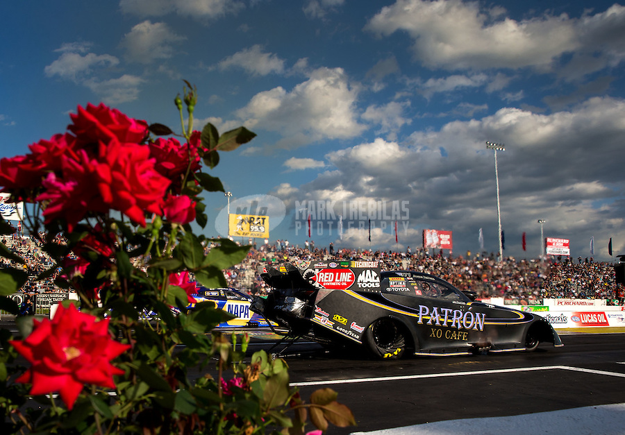 May 30, 2014; Englishtown, NJ, USA; NHRA funny car driver Alexis DeJoria during qualifying for the Summernationals at Raceway Park. Mandatory Credit: Mark J. Rebilas-