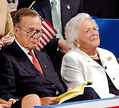 New York, NY - September 2, 2004 --  Former United States President George H.W. Bush and his wife, former first lady Barbara Bush, listen as their son, United States President George W. Bush accepts his party's nomination at the 2004 Republican Convention in Madison Square Garden in New York, New York on Thursday, September 2, 2004.  In his remarks, the President spoke about where he wants to lead the United States for the next four years.  .Credit: Ron Sachs / CNP.(RESTRICTION: No New York Metro or other Newspapers within a 75 mile radius of New York City)