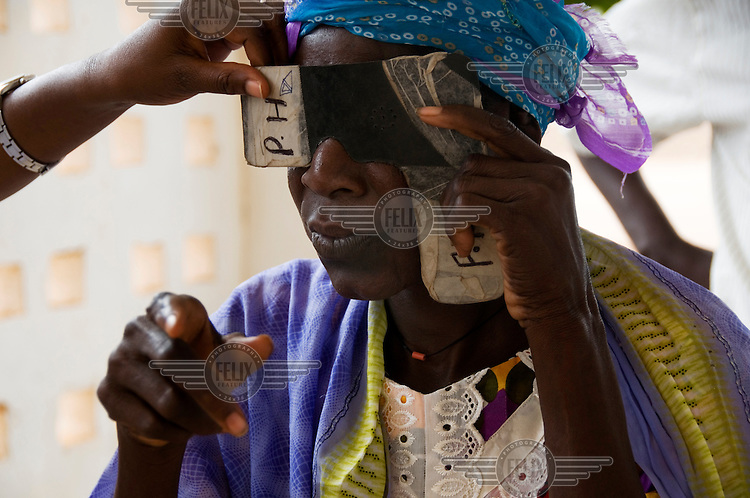 Jully Bah has her eyes tested the day after her cataract operation at the Soma hospital eye clinic.