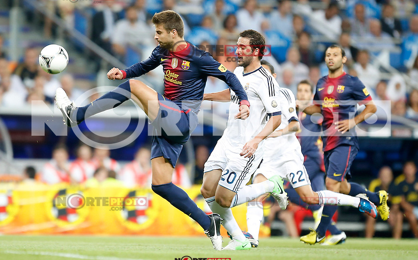 Real Madrid's Gonzalo Higuain against Barcelona's Gerard Pique during Super Cup match. August 29, 2012. (ALTERPHOTOS/Alvaro Hernandez). NortePhoto.com