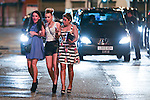 © Joel Goodman - 07973 332324 . No syndication permitted . 01/01/2014 . Manchester , UK . Three women cross the street towards the Printworks nightclub venue . Revellers see in the New Year in Manchester today (January 1st 2014) as police report that officers are at full stretch responding to calls . Photo credit : Joel Goodman