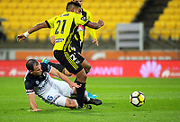 Roy Krishna is fouled during the A-League football match between Wellington Phoenix and Melbourne Victory at Westpac Stadium in Wellington, New Zealand on Friday, 10 January 2018. Photo: Dave Lintott / lintottphoto.co.nz