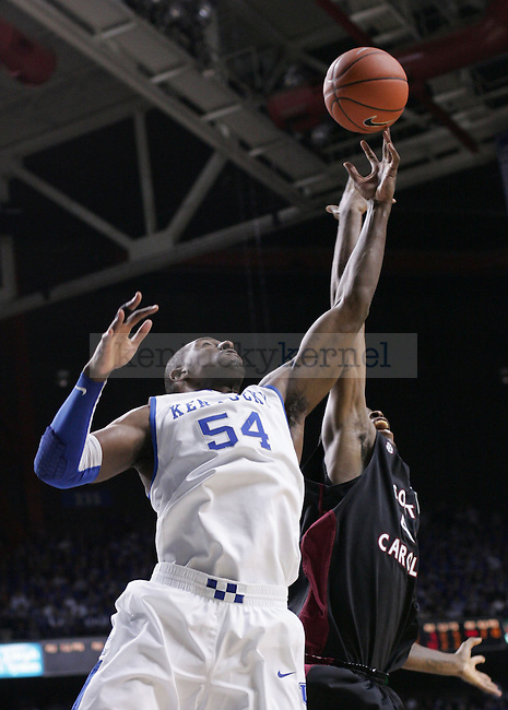 Junior forward Patrick Patterson beats a South Carolina defender to a rebound during the second half of the game at Rupp Arena on Thursday. Photo by Zach Brake | Staff.