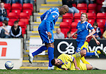 St Johnstone v Kilmarnock....02.04.11 .Michael Duberry reacts to Alexei Eremenko's theatrics.Picture by Graeme Hart..Copyright Perthshire Picture Agency.Tel: 01738 623350  Mobile: 07990 594431