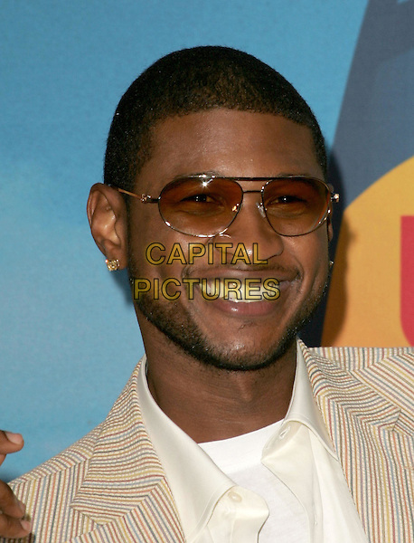USHER.The 2004 Teen Choice Awards held at The Universal Ampitheatre in Universal City, California.August 8, 2004.headshot, portrait, sunglasses, shades, stubble, facial hair.www@capitalpictures.com.sales @capitalpictures.com.©Capital PIctures