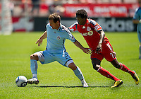 10 July 2010: Colorado Rapids midfielder Jamie Smith #20 and Toronto FC forward Fuad Ibrahim #7 in action during a game between the Colorado Rapids and Toronto FC at BMO Field in Toronto..Toronto FC won 1-0.