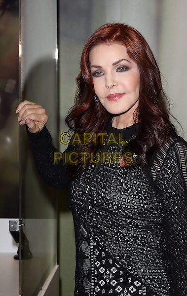 LONDON, ENGLAND - Priscilla Presley with some of the new items on display at the Elvis at The O2: The Exhibition of His Life, at the O2 Arena London on November 3rd 2015<br /> CAP/ROS<br /> &copy;Steve Ross/Capital Pictures