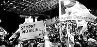 "Some Partito Democratico's supporters - the Italian left-wing Party - hold flags and a banner that reads ""Closer and closer"" before the beginning of Matteo Renzi's speech during a political campaign convention for the Italian government elections in Turin, April 12, 2014."